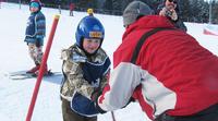 Suomalaisperheet Special Olympics -alppileirillä Puolassa.
